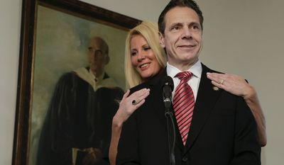 """FILE - In this Tuesday, Nov. 4, 2014, file photo, New York Gov. Andrew Cuomo speaks to members of the media as his partner, Sandra Lee, looks on after casting his ballot, in Mount Kisco, N.Y. In an interview that aired Tuesday, May 12, 2015, on ABC's """"Good Morning America, """" Lee said she has been diagnosed with breast cancer. (AP Photo/Julie Jacobson, File)"""