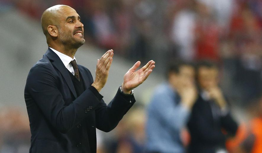 Bayern's head coach Pep Guardiola instructs his players during the soccer Champions League second leg semifinal match between Bayern Munich and FC Barcelona at Allianz Arena in Munich, southern Germany, Tuesday, May 12, 2015. (AP Photo/Matthias Schrader)