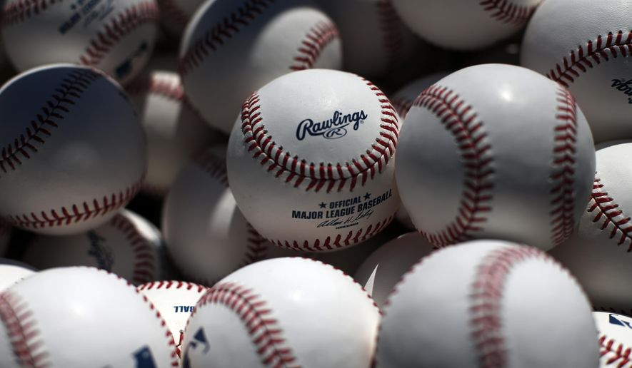 FILE- In this March 8, 2014, file photo, a basket of batting practice balls waits near the batting cage before an exhibition spring training baseball game between the Baltimore Orioles and the Boston Red Sox in Sarasota, Fla. Major League Baseball changed how balls are handled before games this season, adding an extra layer of security in the wake of the Tom Brady flap. (AP Photo/Gene J. Puskar, File)