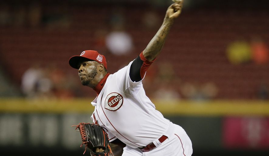 Cincinnati Reds relief pitcher Aroldis Chapman throws during the ninth inning of a baseball game against the Atlanta Braves, Monday, May 11, 2015, in Cincinnati. A wild pitch by Chapman in the ninth allowed Atlanta Braves Phil Gosselin to run home for the game-winning run. The Braves won 2-1. (AP Photo/John Minchillo)