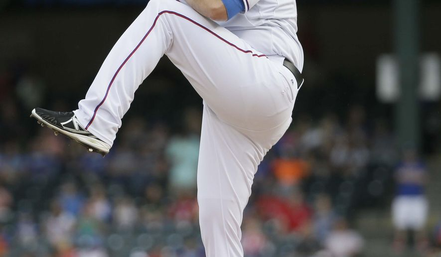 Texas Rangers starting pitcher Colby Lewis winds up to throw during the first inning of a baseball game against the Kansas City Royals in Arlington, Texas, Monday, May 11, 2015. (AP Photo/LM Otero)