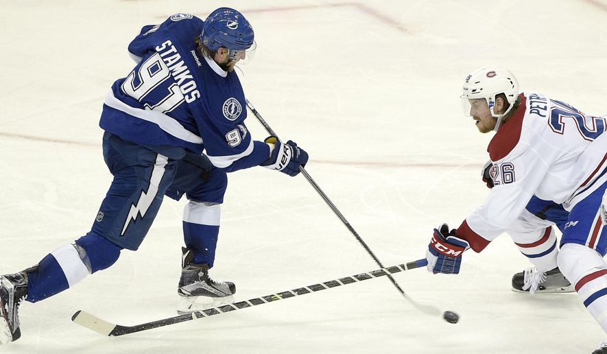 Tampa Bay Lightning center Steven Stamkos (91) makes a shot on goal past Montreal Canadiens defenseman Jeff Petry (26) for a score during the second period of Game 6 of a second-round NHL Stanley Cup hockey playoff series against the Montreal Canadiens in Tampa, Fla., Tuesday, May 12, 2015. (AP Photo/Phelan M. Ebenhack)