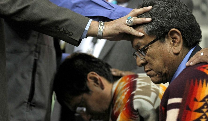 Navajo Nation Vice President Jonathan Nez, left, and Navajo Nation President Russell Begaye receive blessings during their inauguration ceremony at Fighting Scouts Events Center in Fort Defiance, Ariz., Tuesday, May 12, 2015. Begaye easily beat former two-term President Joe Shirley Jr. in a special election last month for the post on the country's largest American Indian reservation. (Alexa Rogals/The Daily Times via AP)