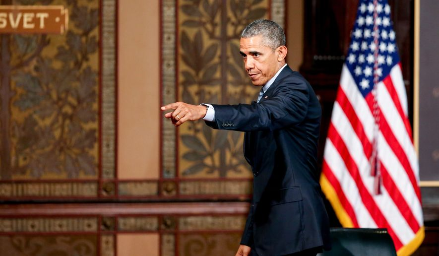 President Obama points to the audience as he departs after speaking at the Catholic-Evangelical Leadership Summit on Overcoming Poverty at Gaston Hall at Georgetown University in Washington on May 12, 2015. (Associated Press)