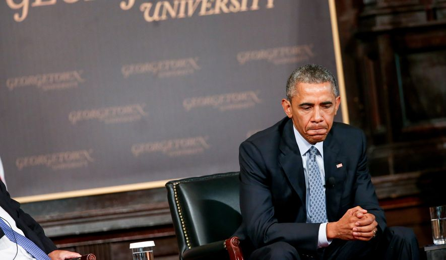 President Barack Obama pauses while speaking at the Catholic-Evangelical Leadership Summit on Overcoming Poverty at Georgetown University in Washington, Tuesday, May 12, 2015. (Associated Press)