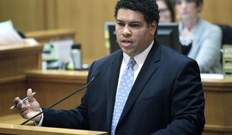 FILE - In this Feb. 26, 2013, file photo, Dane County, Wisc., District Attorney Ismael Ozanne speaks in a Madison, Wis., court. The prosecutor is set to announce Tuesday, May 12, 2015, whether a white police officer will face charges for killing a young unarmed biracial man in Madison. (M.P. King/Wisconsin State Journal via AP, File)