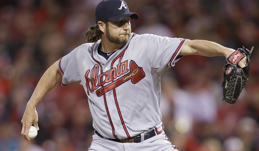 Atlanta Braves relief pitcher Jason Grilli throws in the ninth inning of a baseball game against the Cincinnati Reds, Tuesday, May 12, 2015, in Cincinnati. The Reds won 4-3. (AP Photo/John Minchillo)
