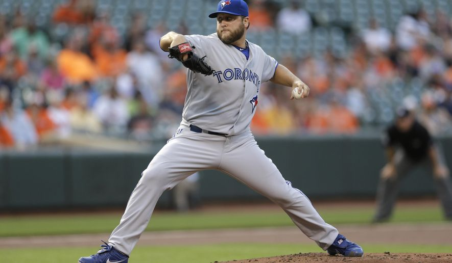 Toronto Blue Jays starting pitcher Mark Buehrle throws to the Baltimore Orioles in the first inning of a baseball game, Tuesday, May 12, 2015, in Baltimore. (AP Photo/Patrick Semansky)
