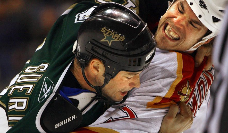 FILE - In this Dec. 7, 2005, file photo, Florida Panthers' Steve Montador, right, fights with Dallas Stars' Bill Guerin (13) during the first period of an NHL hockey game in Dallas. An autopsy of Montador's brain shows the former NHL defenseman had degenerative brain disease.  The 35-year-old Montador, who had multiple concussions during his career with six NHL teams, died in February at home in Mississauga, Ontario.  (AP Photo/Matt Slocum, File)