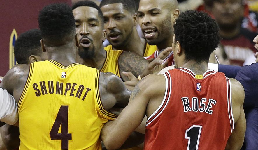 The Cleveland Cavaliers and the Chicago Bulls scuffle during the second half of Game 5 in a second-round NBA basketball playoff series Tuesday, May 12, 2015, in Cleveland. (AP Photo/Tony Dejak)