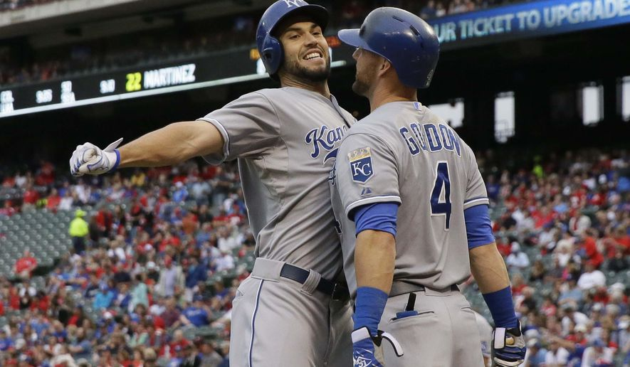 Kansas City Royals' Eric Hosmer, left, bumps chests with teammate Alex Gordon (4) after Hosmer hit a solo home run during the second inning of a baseball game against the Texas Rangers in Arlington, Texas, Tuesday, May 12, 2015. (AP Photo/LM Otero)