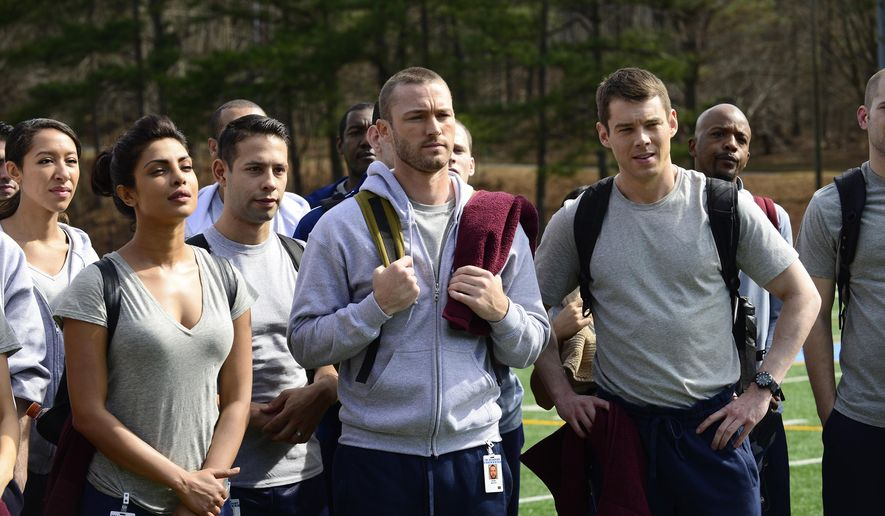 "In this image released by ABC, Priyanka Chopra, from foreground left, Jake McLaughlin and Brian J. Smith appear in a scene from the new series, ""Quantico,"" part of the new season line-up on ABC. Chopra, 32, a former Miss World, is a popular Bollywood actress who has starred in films like the romance musicals ""Fashion"" and ""Andaaz."" (Guy D'Alema/ABC via AP)"