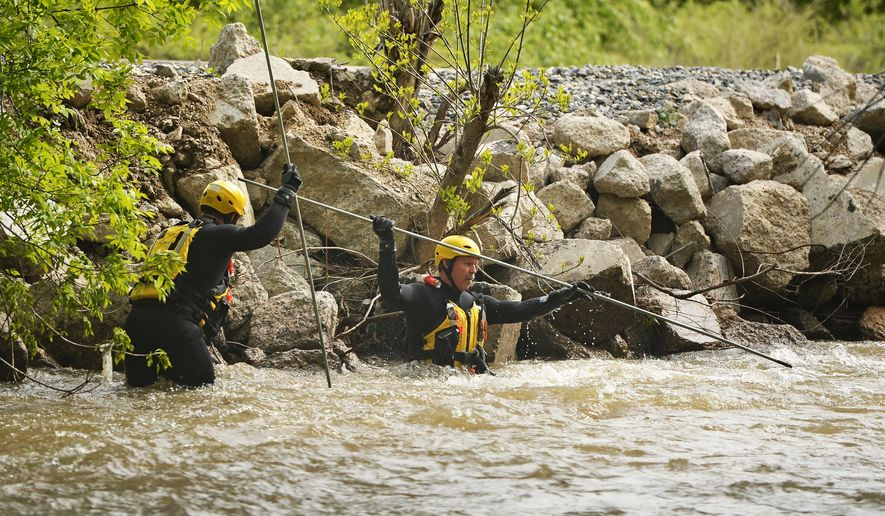 Rescuers search for Chris Danko on Boulder Creek, Tuesday, May 12, 2015, in Boulder, Colo. Danko was reported missing by a friend Monday evening after going tubing. (RJ Sangosti/The Denver Post via AP)