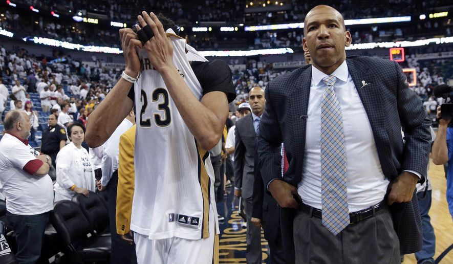 FILE - In this April 25, 2015, file photo, New Orleans Pelicans forward Anthony Davis (23) and head coach Monty Williams walk off the court after losing 109-98 to the Golden State Warriors in Game 4 in the first round of the NBA basketball playoffs in New Orleans. The Pelicans fired Williams on Tuesday, May 12, 2015. (AP Photo/Gerald Herbert, File)