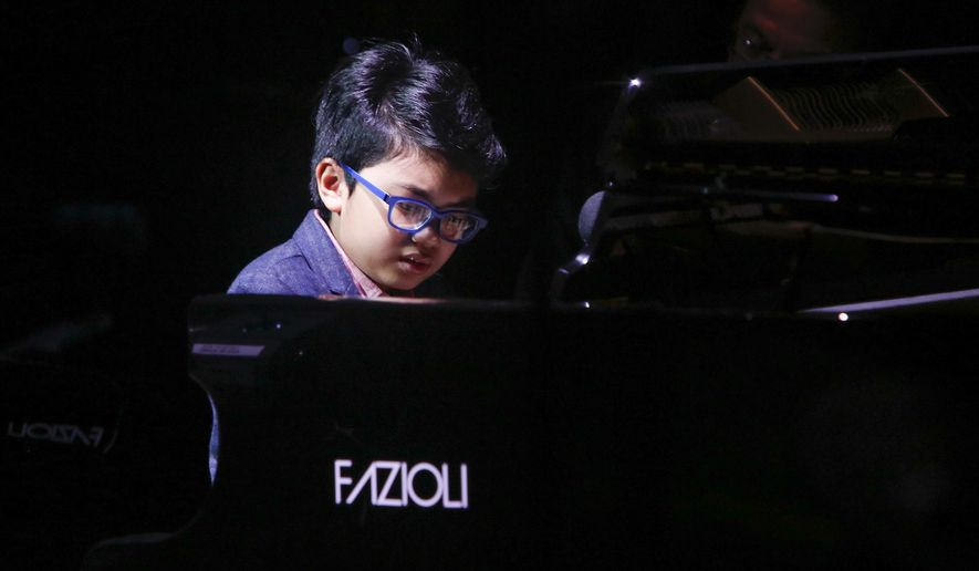 """FILE - In this Oct. 24, 2014 file photo, music prodigy Joey Alexander performs at the 13th annual """"A Great Night in Harlem"""" gala concert, presented by The Jazz Foundation of America to benefit The Jazz Musicians Emergency Fund, at The Apollo Theater in New York. Alexander releases his album, """"My Favorite Things,"""" on Tuesday, May 12.  (Photo by Mark Von Holden/Invision/AP, File)"""