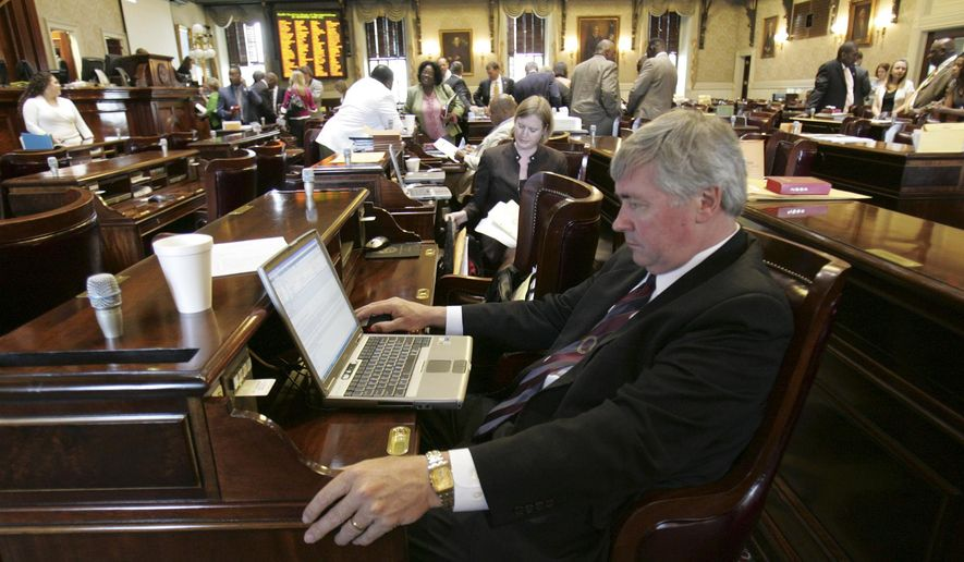 In this May 21, 2009, file photo, state Rep. Nelson Hardwick, R- Surfside Beach, looks at his computer as other members of the House pack up as the legislative session ends at the Statehouse in Columbia, S.C. Hardwick has resigned following a complaint investigated by House Speaker Jay Lucas. (AP Photo/Mary Ann Chastain, File)