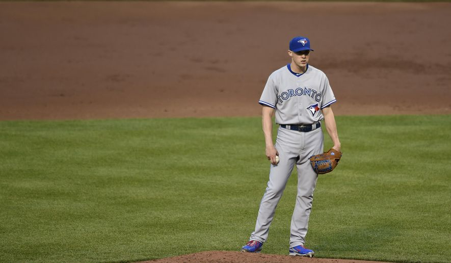 Toronto Blue Jays pitcher Aaron Sanchez stands on the mound after giving up five runs to the Baltimore Orioles in the fifth inning of a baseball game Wednesday, May 13, 2015 in Baltimore. (AP Photo/Gail Burton)