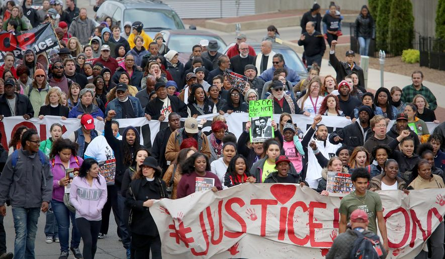 Supporters of Tony Robinson's family participate in a march along E. Wilson St., Tuesday, May 12, 2015, in Madison, Wisc. Dane County District Attorney Ismael Ozanne announced Tuesday that Madison Police Officer Matt Kenny would not face charges for the shooting death of Robinson. (John Hart/Wisconsin State Journal via AP)