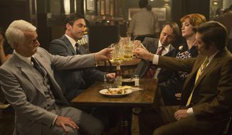 "This image released by AMC shows, from left, John Slattery as Roger Sterling, Jon Hamm as Don Draper, Vincent Kartheiser as Pete Campbell, Christina Hendricks as Joan Harris and Kevin Rahm as Ted Chaough, in a scene from the final season of ""Mad Men."" The series finale airs on Sunday.  (Justina Mintz/AMC via AP)"