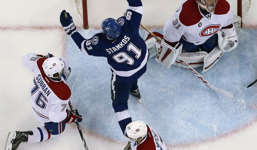 Tampa Bay Lightning center Steven Stamkos (91) celebrates after scoring past Montreal Canadiens goalie Carey Price (31) during the second period of Game 6 of a second-round NHL Stanley Cup hockey playoff series Tuesday, May 12, 2015, in Tampa, Fla. Looking on is Canadiens P.K. Subban (76) and Torrey Mitchell (17). The Lightning won the game 4-1 eliminating the Canadiens. (AP Photo/Chris O'Meara)