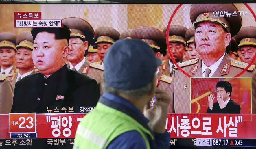 "A man watches a TV news program reporting that People's Armed Forces Minister Hyon Yong Chol was killed by anti-aircraft gunfire, at Seoul Railway Station in Seoul, South Korea, Wednesday, May 13, 2015. North Korean leader Kim Jong Un executed his defense chief for sleeping during a meeting and talking back to the young leader, South Korea's spy agency told lawmakers Wednesday, citing what it called credible information. The part of letters on the bottom ""Pyongyang, executed by anti-aircraft gunfire."" (AP Photo/Lee Jin-man)"