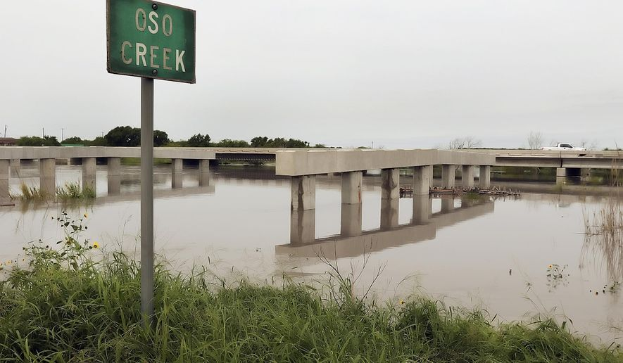 Flooding has stopped work on the new Oso Creek Bridge in Corpus Christi, Texas, Tuesday, May 12, 2015. Flash flooding in the region closed roads and forced some East Texas residents from their homes. (George Tuley/Corpus Christi Caller-Times via AP) MANDATORY CREDIT; MAGS OUT; TV OUT