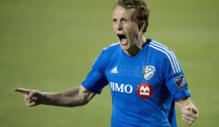 Montreal Impact's Wandrille Lefèvre reacts after his team scored a goal against the Toronto FC during the second half of a soccer semifinal in the Canadian Championship in Toronto on Wednesday, May 13, 2015. (Nathan Denette/The Canadian Press via AP)