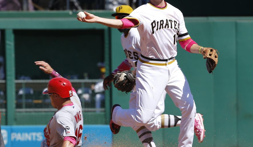 Pittsburgh Pirates shortstop Jordy Mercer, right, relays the ball on to first after forcing St. Louis Cardinals' Kolten Wong out at second on the front half of a double play hit by Jhonny Peralta to end the Cardinals' seventh inning of a baseball game, Sunday, May 10, 2015, in Pittsburgh. The Pirates won 4-3. (AP Photo/Keith Srakocic)