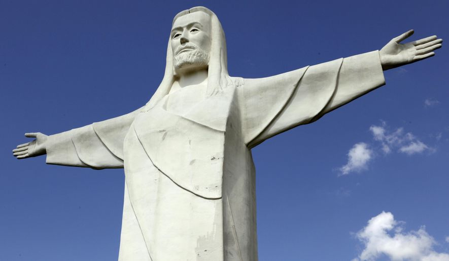 File - In this May 6, 2015 file photo, a 66-foot tall statue of Jesus stands near Eureka Springs, Ark. Voters in Eureka Springs voted overwhelmingly Tuesday, May 12, 2015 to keep a measure that would prohibit the city and private businesses from discriminating against someone based on their sexual orientation and gender identity. (AP Photo/Danny Johnston, File)
