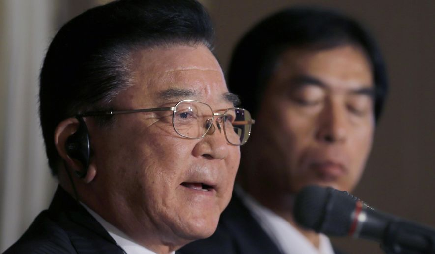 """Kampei Shimoide, left, mayor of Minamikyushu, speaks during a press conference at the Foreign Correspondents' Club of Japan in Tokyo, Wednesday, May 13, 2015. The Japanese city's plan to seek UNESCO recognition for its collection of documents related to its role as a launching base for """"kamikaze"""" suicide attacks in the desperate last months of World War II is raising questions over how such memories should be preserved. Shimoide and others associated with the project said Wednesday they hope that registering the document collection as a UNESCO """"Memory of the World"""" will help ensure it will convey the horrors and suffering of the war to future generations. (AP Photo/Shizuo Kambayashi)"""