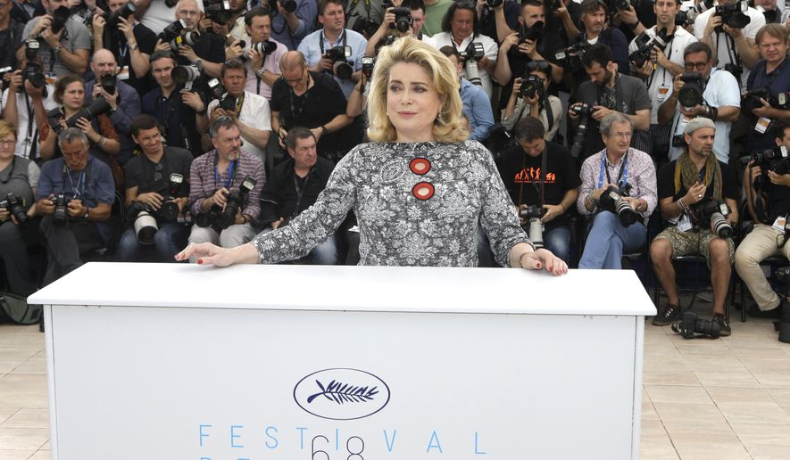 Catherine Deneuve poses for photographers during a photo call for La Tete Haute (Standing Tall), at the 68th international film festival, Cannes, southern France, Wednesday, May 13, 2015. (AP Photo/Lionel Cironneau)