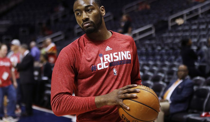 Washington Wizards' John Wall warms up before the start of Game 5 of the second round of the NBA basketball playoffs against the Atlanta Hawks Wednesday, May 13, 2015, in Atlanta. (AP Photo/John Bazemore) **FILE**