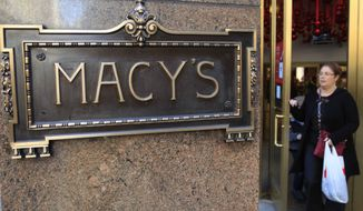 FILE - In this Nov. 8, 2011 file photo, a shopper leaves the Macy's department store in New York. Macy's Inc. reports quarterly financial results on Wednesday, May 13, 2015. (AP Photo/Frank Franklin II)
