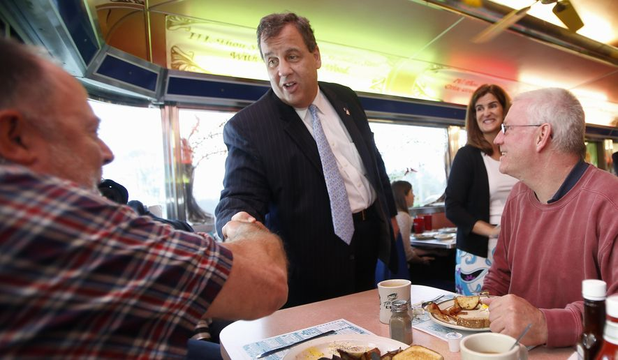 New Jersey Gov. Chris Christie, accompanied by his wife Mary Pat, shakes hands Bob Belk who was having breakfast with Greg Houle at the Tilton Diner, Wednesday, May 13, 2015, in Tilton, N.H. The diner is a popular stop for candidates running for president in the nation's earliest presidential primary state. (AP Photo/Jim Cole)