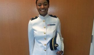 The prototype dress uniform for women has the same high collar as the men's. (Courtesy of the U.S. Navy)
