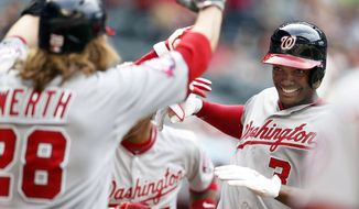 Washington Nationals center fielder Michael Taylor (3) celebrates with Jayson Werth and Yunel Escobar after hitting a grand slam in the ninth inning during a baseball game against the Arizona Diamondbacks, Wednesday, May 13, 2015, in Phoenix. The Nationals defeated the Diamondbacks 9-6. (AP Photo/Rick Scuteri)