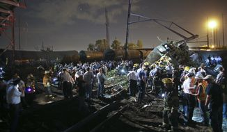 Emergency personnel work the scene of an Amtrak train derailment in Philadelphia. (Associated Press)