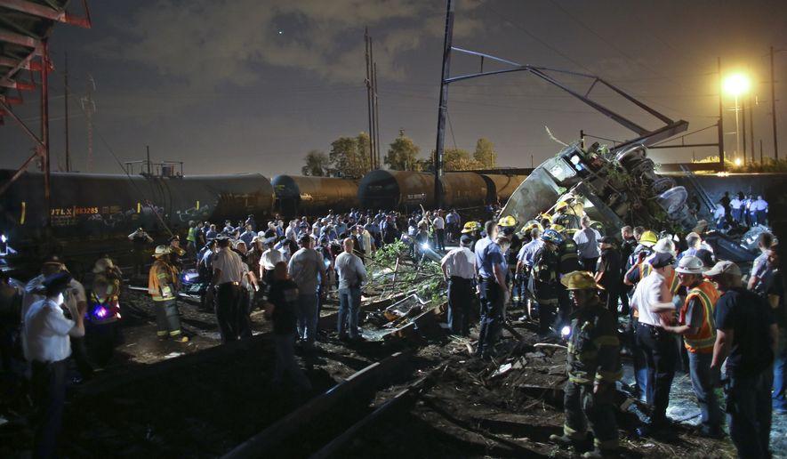 Emergency personnel work the scene of an Amtrak train derailment in Philadelphia. (Associated Press)
