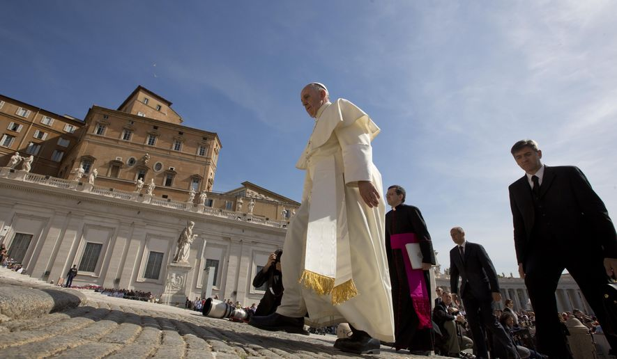 Pope Francis arrives for his weekly general audience in St. Peter's Square at the Vatican, Wednesday, May 13, 2015. (AP Photo/Alessandra Tarantino)