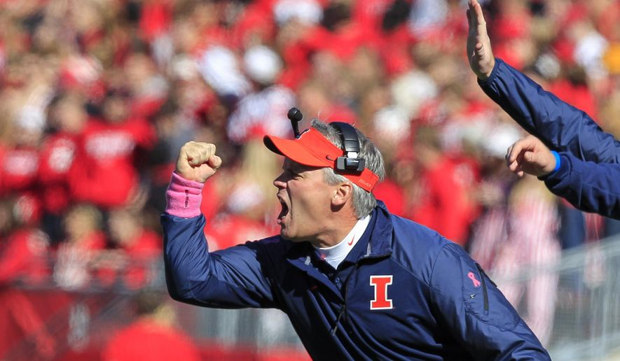 FILE - In this Oct. 11, 2014, file photo, Illinois coach Tim Beckman directs his team during the first half of an NCAA college football game against Wisconsin, in Madison, Wis. A national advocacy group for college football players says complaints about Illinois coach Tim Beckman's handling of a former player's injuries should be investigated by someone outside the university. National College Players Association Executive(AP Photo/Andy Manis, File)