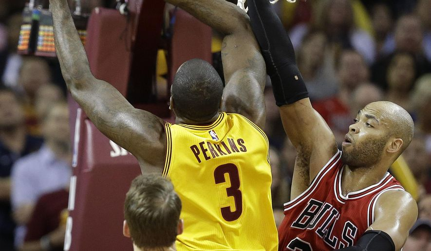 Cleveland Cavaliers center Kendrick Perkins (3) puts up a shot against Chicago Bulls forward Taj Gibson (22) during the first half of Game 5 in a second-round NBA basketball playoff series Tuesday, May 12, 2015, in Cleveland. (AP Photo/Tony Dejak)