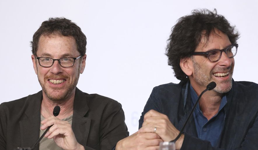 Jury presidents Ethan Coen, left, and Joel Coen laugh during a press conference for the jury at the 68th international film festival, Cannes, southern France, Wednesday, May 13, 2015. (AP Photo/Thibault Camus)
