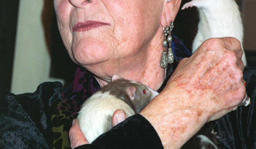 FILE - In this April 16, 1997, file photo, performance artist Rachel Rosenthal cuddles rats during a book signing in West Hollywood, Calif. Rosenthal, the performance and theater artist who embraced environmentalism during a half-century career devoted to the avant garde, died Sunday, May 10, 2015, at her Southern California home. She was 88. (AP Photo/Susan Goldman, File)