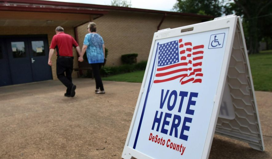 Voters arrive at the polls at Olive Branch Middle School in Olive Branch, Miss., Tuesday, May 12, 2015. Voters cast ballots Tuesday in the special election to fill the First Congressional District seat left open by the death of Republican Rep. Alan Nunnelee, who died of brain cancer in February. (Stan Carroll/The Commercial Appeal via the AP)