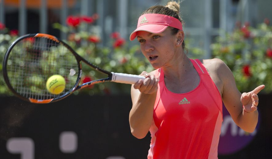 Simona Halep, of Romania, returns the ball to Alison Riske, of the United States, during their match at the Italian Open tennis tournament, in Rome, Wednesday, May 13, 2015. (AP Photo/Andrew Medichini)
