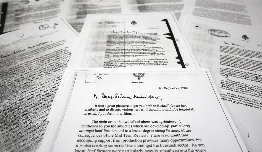 "A copy of the letter that Prince Charles The Prince of Wales wrote to the then Prime Minister Tony Blair, front centre, dated Sept. 8, 2004, one of a series of his private letters to government ministers that have been released Wednesday May 13, 2015, by the government following a lengthy legal battle.  The British government has released 27 previously secret letters written by Prince Charles to government officials, known as the ""black spider"" memos, letters that were the subject of a lengthy legal battle by Guardian newspaper journalist Rob Evans that pitted Charles' right to privacy against the public's right to know. (Philip Toscano / PA via AP) UNITED KINGDOM OUT - NO SALES - NO ARCHIVES"
