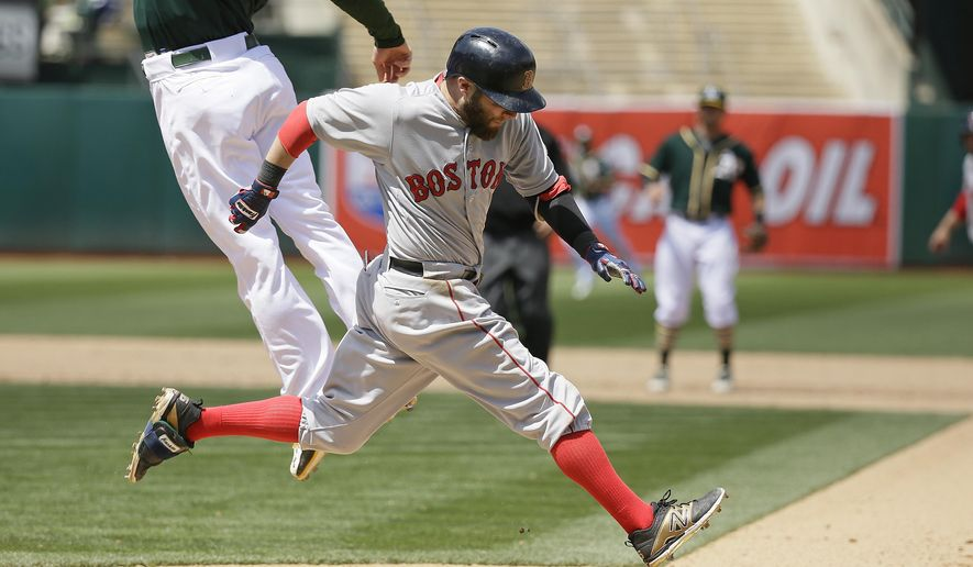 Boston Red Sox's Dustin Pedroia runs safely to first base as Oakland Athletics first baseman Mark Canha leaps for the throw in the eighth inning of their baseball game Wednesday, May 13, 2015, in Oakland, Calif. The Red Sox scored a run on the play and Athletics shortstop Marcus Semien was given a throwing error on the play. (AP Photo/Eric Risberg)
