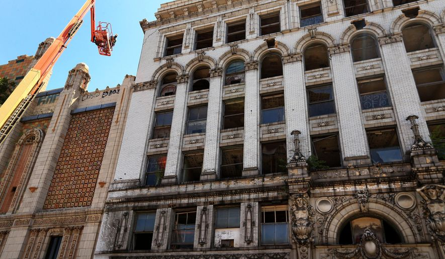 In this April 30, 2015, photo workers with Hayden Wrecking Co. remove bricks from the Murphy Building that is under demolition in East St. Louis. Kimberly Williams, the owner of the historic East St. Louis building filed a temporary restraining order seeking to halt the property's demolition by the city. (Christian Gooden/St. Louis Post-Dispatch via AP)  EDWARDSVILLE INTELLIGENCER OUT; THE ALTON TELEGRAPH OUT; MANDATORY CREDIT