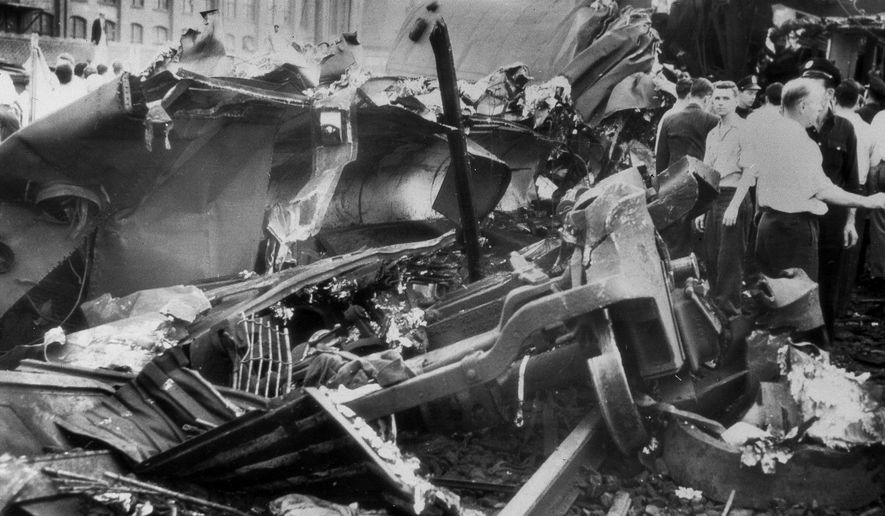 FILE - This Sept. 7, 1943 file photo shows the wrecked cars of the Pennsylvania Railroad's Congressional Limited train, in Philadelphia. The Labor Day train jammed with 541 passengers derailed, killing 79 passengers and injuring117 others. The May 12, 2015 derailment of an Amtrak train in Philadelphia was not the first rail disaster to occur in that area. The high-speed Congressional Limited jumped the rails in an area known as Frankford Junction. It is about a mile from where the Amtrak wreck occurred Tuesday night. (AP Photo, File)