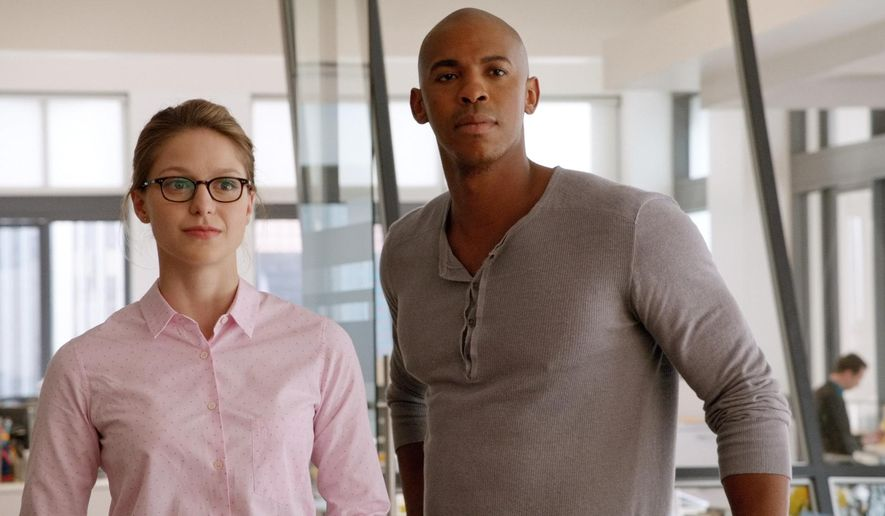"This image from video released by CBS shows Melissa Benoist, left, and Mehcad Brooks in a scene from ""Supergirl."" The show is one of five new programs CBS will release in the fall. (CBS via AP)"